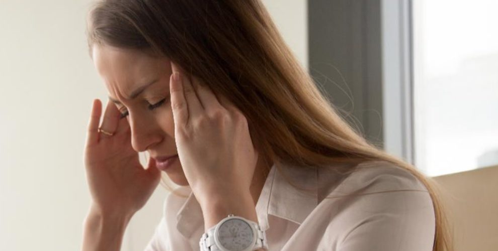 A woman deals with caffeine-induced headache