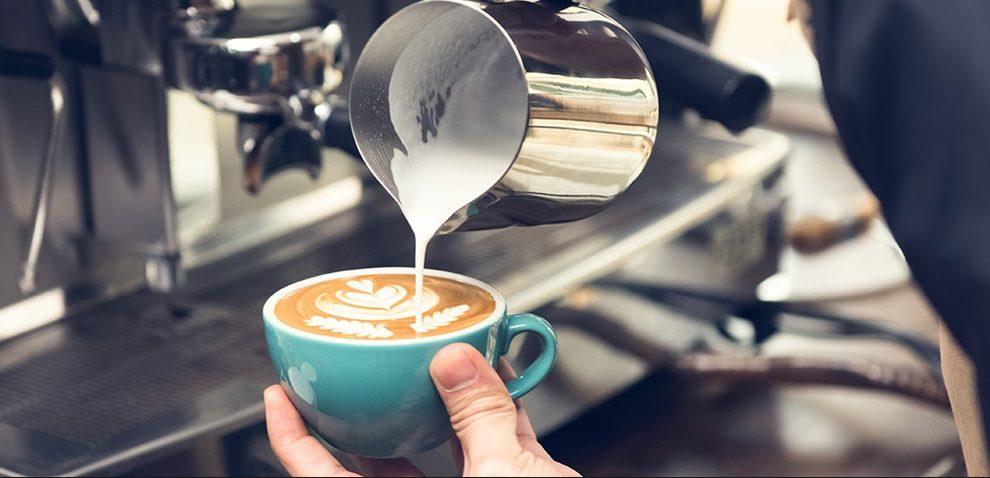 Barista creating coffee art